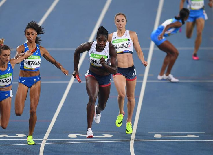 RIO DE JANEIRO, BRAZIL - AUGUST 19: Emily Diamond passes the baton to Anyika Onuora of Great Britain in Round One of the Women's 4 x 400m Relay on Day 14 of the Rio 2016 Olympic Games at the Olympic Stadium on August 19, 2016 in Rio de Janeiro, Brazil. (Photo by Shaun Botterill/Getty Images) — in Rio de Janeiro, Brazil.
