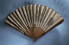 Paper and wood map fan, English (Bath), c. 1795. An open folding fan made of plain medium brown wood sticks and guards held together at the bottom end with a rivet. The leaf of the fan is made of cream paper printed with a map of Bath. The title is printed: 'Plan of Bath from an Actual Survey with the Improvements to the present Year 1795'. The north side of the map is to the right-hand side of the fan.