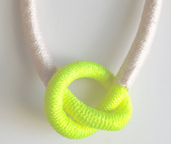 Neon yellow knot necklace wrapped in light pink by plaitknot