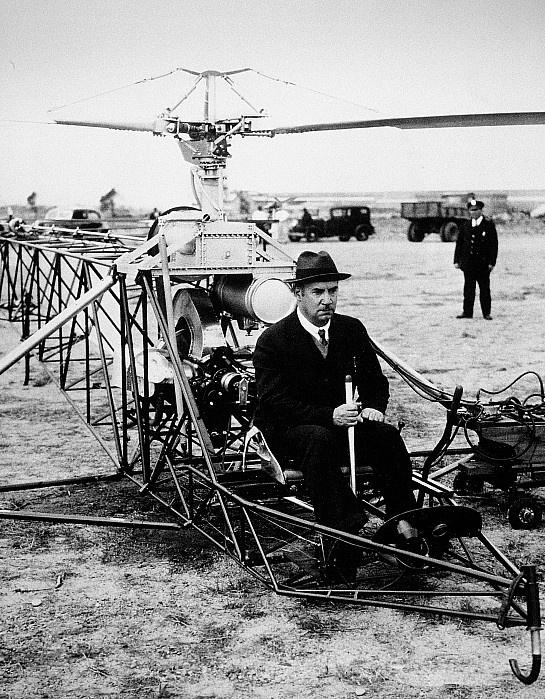 IGOR IVAN SIKORSKY (1889-1972). American (Ukrainian-born) aeronautical engineer. Sikorsky preparing to demonstrate a VS-300 helicopter, Bridgeport, Connecticut, 20 May 1940.