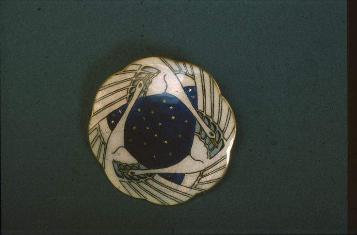 Gustav Gaudernack design for own collection. Gilt silver brooch with 3 stylized swans on dark blue ground in translucent enamel. 1910-1914