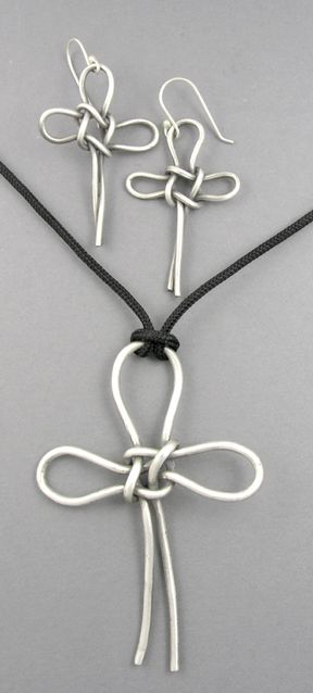 Knots: couldn't find a tutorial on this, but I might be able to figure this out on my own.  Love this cross. (Diy Necklace Knot)