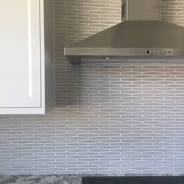 Absolutely in LOVE with this #TileTuesday Vogue gray convex mosaic installation…