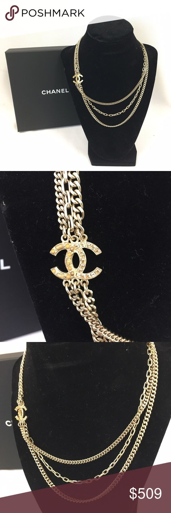 Chanel Gold Multi-chain Necklace Beautiful three strand mixed chain necklace with classic CC emblem. The CC is a mix of stones and diamonds. This is 100% authentic and from my personal collection. We purchased it in November at the Wynn in Las Vegas. It has only been worn twice and is in like new condition. Includes original box and protective sleeve. Note the original price tag as well. CHANEL Jewelry Necklaces