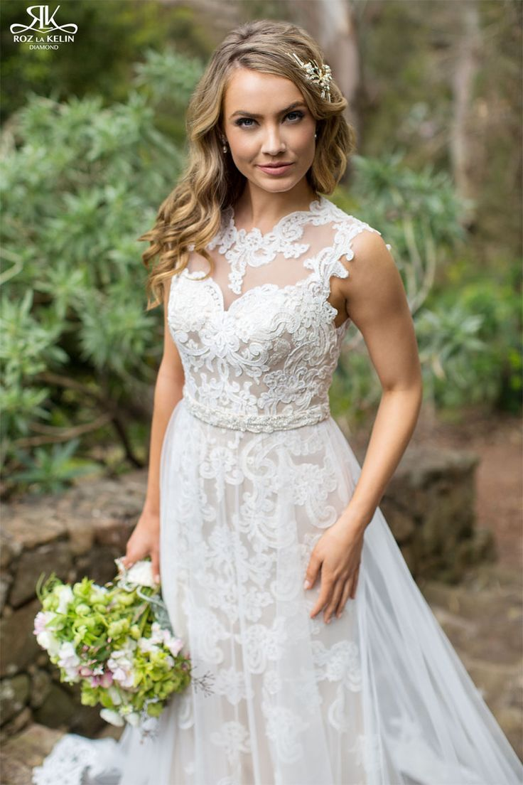 Capri, gown, train Set: The Capri set is from the Diamond collection. Beautifully laced throughout the dress but also comes with a tulle train.