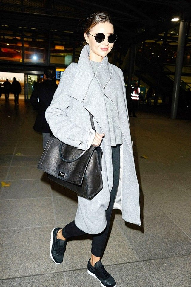 parisienne how to pull off the oversized coat sneakers look