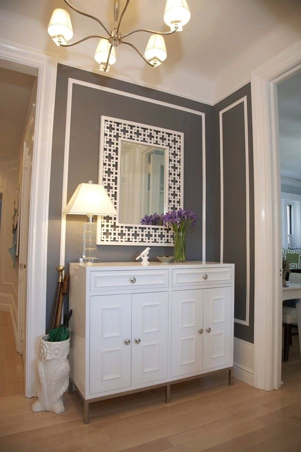White-painted pieces (LOVE the MIRROR) & molding on dark walls --  COCOCOZY: See This House: NYC decor enthusiast decorates her own delightful dwelling