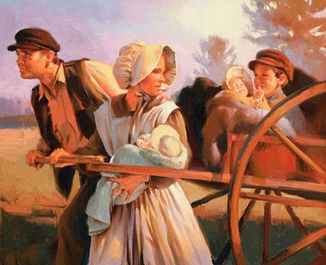 a pioneer mormon family pulling a handcart