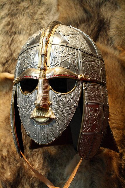 Ceremonial Mask of Sutton Hoo:  Sutton Hoo, near Woodbridge, in Suffolk, England is the site of two 6th- and early 7th-century cemeteries. One contained an undisturbed ship burial including a wealth of Anglo-Saxon artifacts of outstanding art-historical and archaeological significance, now held in the British Museum in London.  by Malcolm Bott