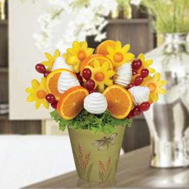 Sunny Day Bouquet - An adorable orange slices, pineapple daisy flowers, grapes and white chocolate dipped strawberries. You can create your own edible fruit arrangements. Price starts from $35   http://www.VaaV.ca
