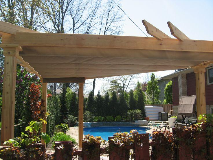 Custom triangle cedar pergola kit with an extended canopy creating a shady spot by the pool - Gazebo pergola designs dream spot ...