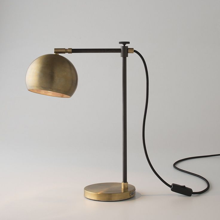 We fused the arcing lines of a Scandinavian classic with handcrafted, vintage-inspired materials to create this Schoolhouse Electric Original. A study in simplicity and elegance, this midcentury modern desk lamp provides precise illumination.  The lamp offers a juxtaposition of light, finish and texture. The handspun brass is hand-finished with an aged black patina interior reminiscent of vintage industrial design. The no-gloss, waxed finish casts an ambient light that is both diffuse and…