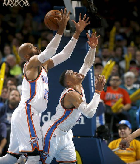 Oklahoma City's Taj Gibson (22) grabs a rebound over Oklahoma City's Russell Westbrook (0) during an NBA basketball game between the Oklahoma City Thunder and the Utah Jazz at Chesapeake Energy Arena in Oklahoma City, Tuesday, Feb. 28, 2017. Photo by Bryan Terry, The Oklahoman