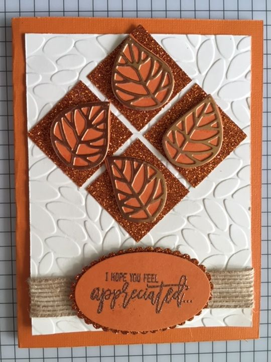 I fought the glimmer paper and the foil paper at the same time and set them aside and later I noticed they were on top of each other and knew they had to go together for a fall color scheme.