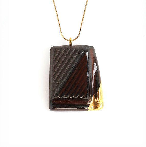 Slightly Melted Gold Glazed Dark Chocolate Jewellery by TADAM! Design.