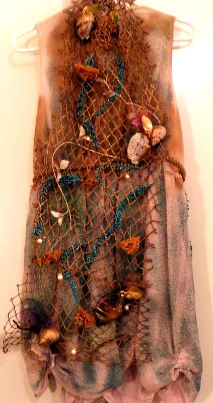 Backside of Siren Costume! Net with hand sewn sea shells, sea foam and seaweed.