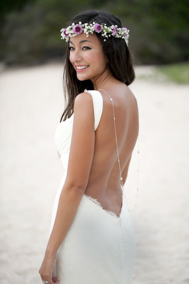 Get inspired: This lovely beach bride dons a stunning backless wedding gown, and tops it off with a simple yet stunning back necklace. Wow!
