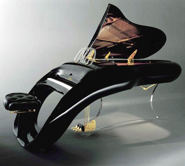 Ergonomic curved computer keyboards might have inspired the unique design of Shimmel firm's Pegasus Grand Piano. RESEARCH -DdO:) - http://www.pinterest.com/DianaDeeOsborne/instruments-for-joy/ - At the heart is a cast-iron base plate, supporting 220 strings  10,000+ components. Model name comes from electronically controlled lid having a gold figure of winged horse Pegasus. Flying design of flow.
