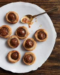 This high-brow take on pigs in a blanket swaps spicy andouille sausage for the hot dogs and adds sweet mustard chutney as a condiment.