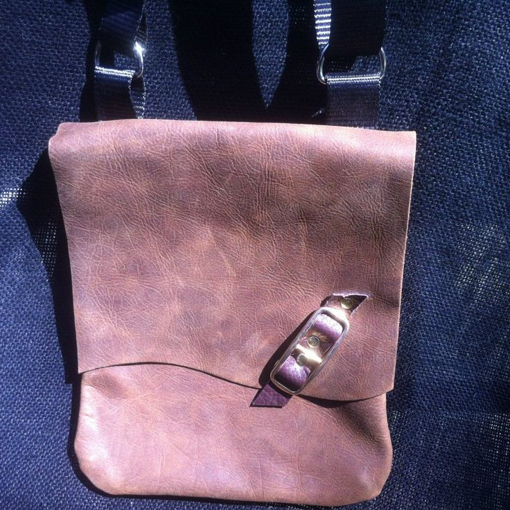 Leather Sling Bag. Meausures 18cm Wide and 24cm Height.