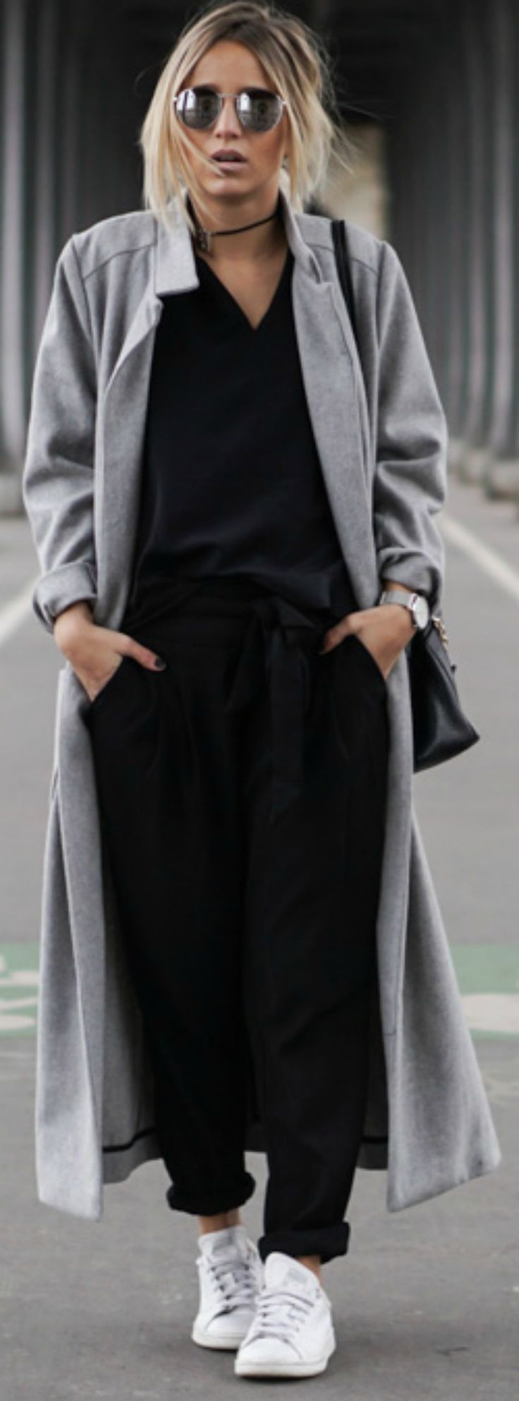 Camille Callen débuts an awesome casual style here, combining stylish baggy trousers with a simple V neck while tying the look together with a gorgeous marl grey maxi coat from Sheinside. An authentic pair of Adidas Stan Smiths will also make the perfect finish to any maxi coat outfit. Top: Zara, Trousers: Mango, Coat: Sheinside, Sneakers: Adidas. #womenscardigan #womensouterwear #womensjacket #scarves #scarf #fashion