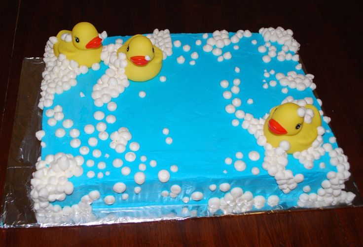 White sheet cake done for baby shower.  Very simple to do.