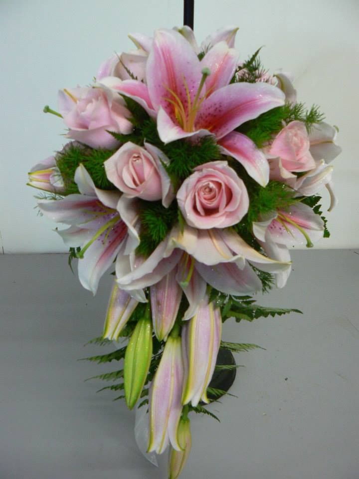 Classic pink roses with hot pink oriental lilies - simple yet stylish teardrop