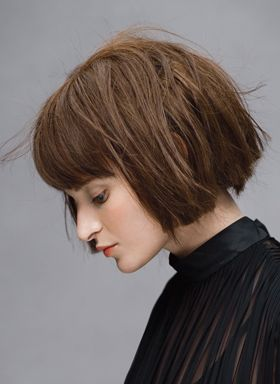 cool edgy bob with bangs. Not sure if I could pull it off, but saw someone with this recently and it looked great