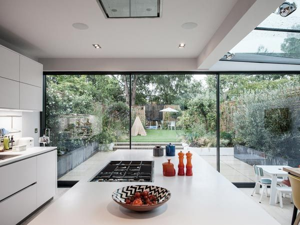 This project includes the complete refurbishment and extension of a 3 storey Victorian terraced house in East Dulwich. The ground floor was extensively remodelled to create a more a free-flowing sequence of open plan contemporary living spaces leading to the new rear extension and garden beyond. The wrap-over structurally glazed roof to the rear extension provides a key design feature allowing natural daylight to flood into the kitchen and dining spaces; while minimal sliding glazed doors cre…