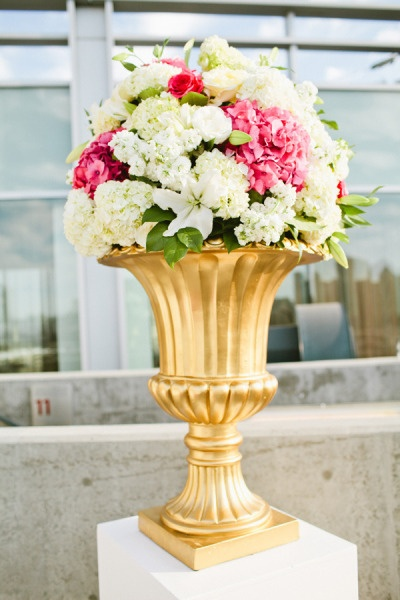 White Columns Gold Urn Fill With All White Flowers For