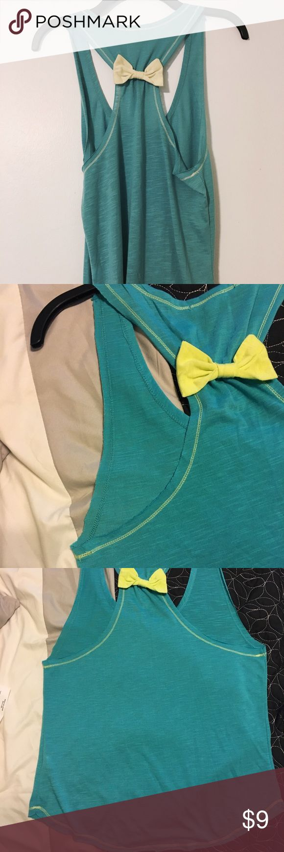 Blue and Green tank top with a bow Such a cute tank top, I just never wear. Worn once. Great condition. Super cute for summer. 💞 (or, since it's so hot in Fl, you could wear it in January😉) Belle Du Jour Tops Tank Tops