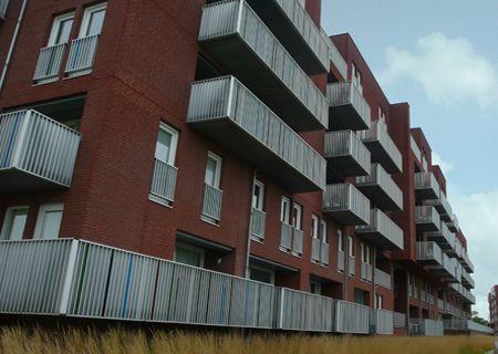 Lance Martosoedarmo Dit is gebouw is ook in de dichterswijk te vinden. onze wijk moet qua uiterlijk hierbij aansluiten