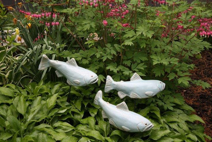 Maine artist Tyson. M Weiss makes ceramic garden fish. I like the