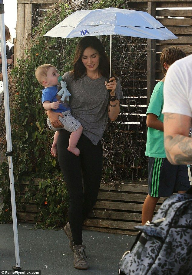 Barefoot Bodhi: Megan's tiny tot went barefoot at the birthday bash while the grown-ups got to doff their shoes and wander around in their socks