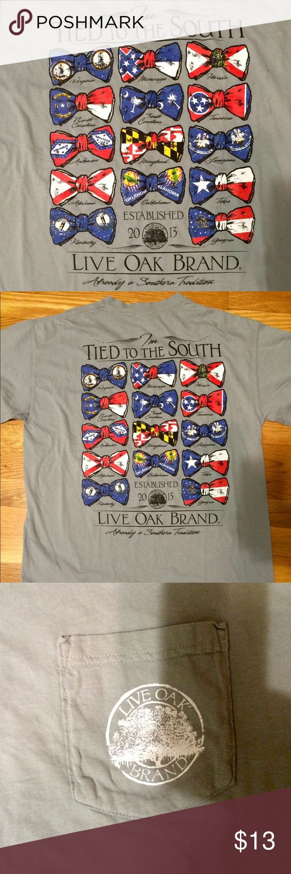 "Live Oak Brand Southern T-Shirt Brand new, never worn Live Oak Brand ""tied to the South"" short sleeve t-shirt. Gray color features bow ties of all Southern states with their flags. Size Medium. Comfort Colors shirt. Front pocket. Live Oak Tops Tees - Short Sleeve"
