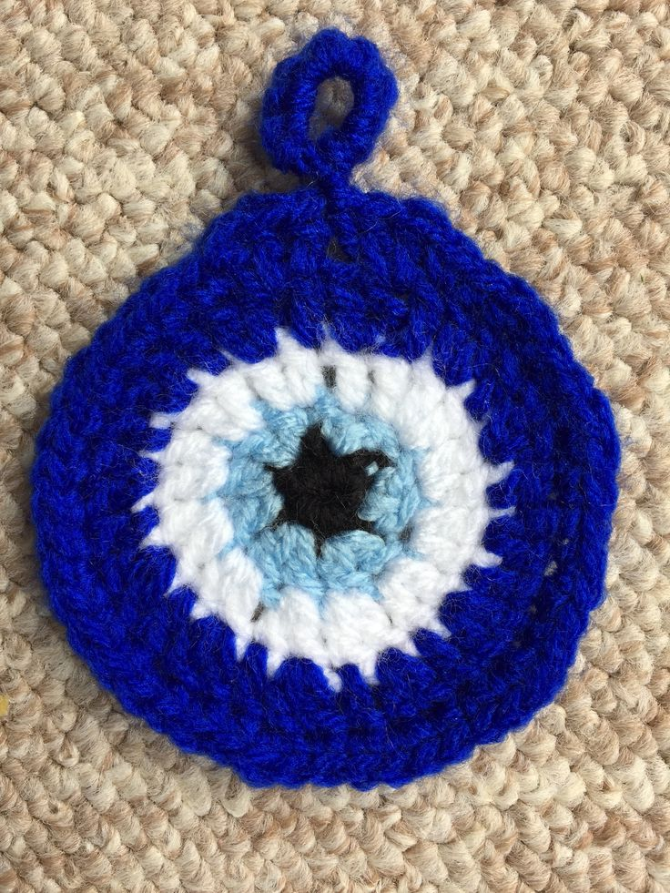 My first attempt at my blue-eye crocheted keyring! It is a little too large and I will need to go over some crochet videos once I get the time. I will then give it another go, making it smaller and more teardrop shaped.