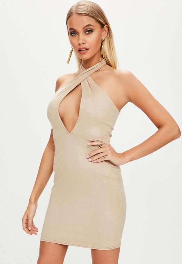 This nude bodycon dress features faux suede fabric,cross over strap and plunge neckline.