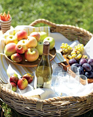 baskets with fruit and wine