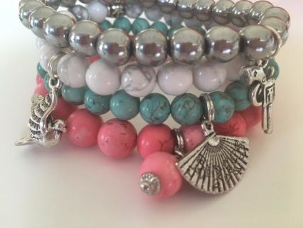 Simply Single elegant dyed  Howlite Bracelet with charm ​ They come in Turquoise, Hemmatite, Pink & White Marble Buy one or buy two ! they look fabulous on their own or layered.   All Savannah Rose Jewellery is lovingly handmade from my wee studio at home just for you.  Made in New Zealand  Enjoy !
