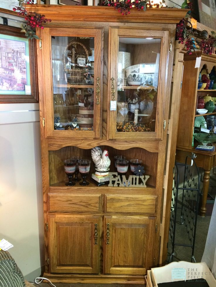 "Oak Corner Cabinet with Doors This oak corner cabinet has plenty of display area for your collectibles both behind the glass doors and on the shelf below. On the bottom is two doors and lots of room for storage!  Dimensions are 34"" x 20.5"" x 76"". http://stores.myresaleweb.com/the-perfect-piece-home-furnishings/item/corner-cabinet-w-doors?id=48483"