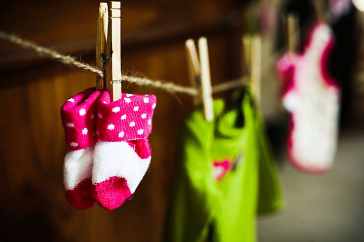 Use clothes pins to hang baby/kid socks so they're easier to see than in the drop baskets