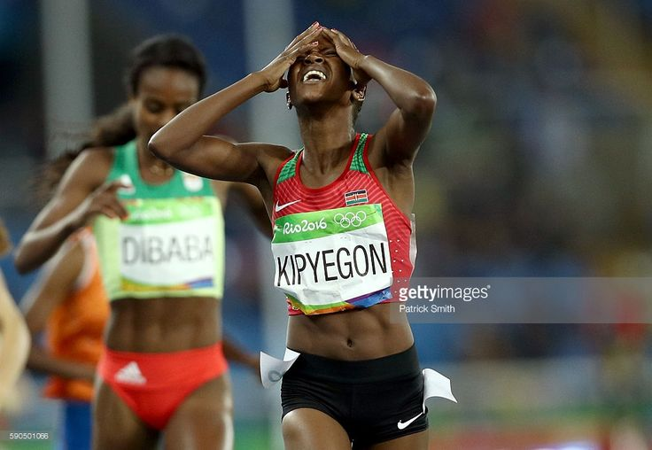 Faith Chepngetich Kipyegon of Kenya reacts as she wins the gold medal in the…