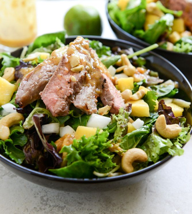 Thai Steak Salad with Roasted Chili Mango Vinaigrette - the marinade from these healthy thai steak tacos and used it for the meat, prepped a salad with tons of salty cashews, then roasted the heck out of some mangos until they were caramely and pureed them into a dressing.
