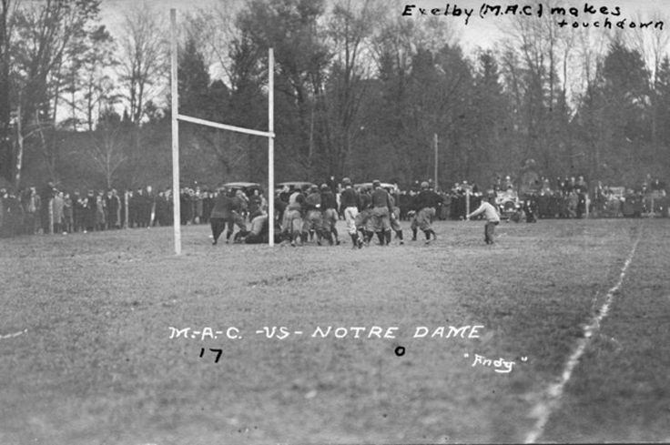 """An action shot from a M.A.C. vs Notre Dame football game. According to the front, """"Exelby (M.A.C.) makes a touchdown."""" The final score given..."""