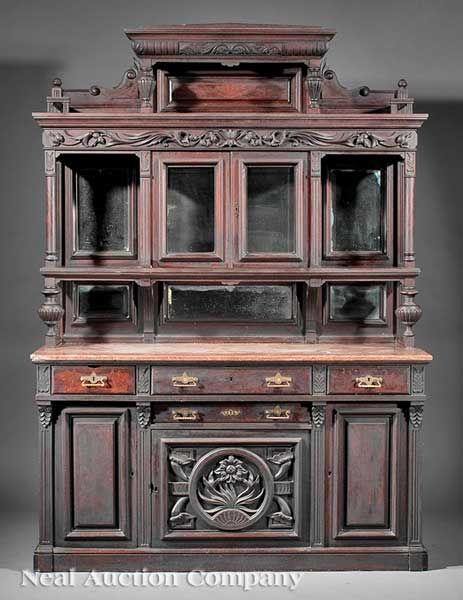 An American Renaissance Carved and Burled Walnut Sideboard,