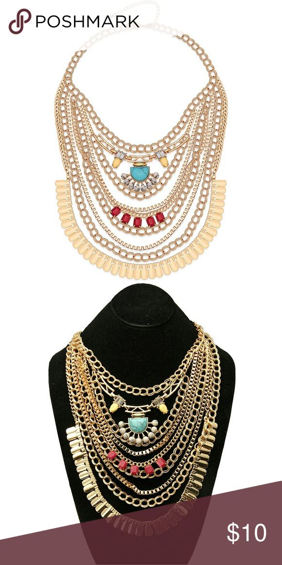 Layered Imitation Gold Statement Necklace Acrylic Turquoise, Red and Yellow Gemstones Layered Imitation Gold Statement Necklace  Evoke the warrior within you while wearing this dynamic imitation gold statement necklace with layers of detailed, fluid strands. Compellingly beautiful semiprecious stones take up the center and reflect the strength within. Ranging from the bright teal of turquoise, to fascinating yellows and bold reds, you'll feel energized and emboldened to take your day head on…