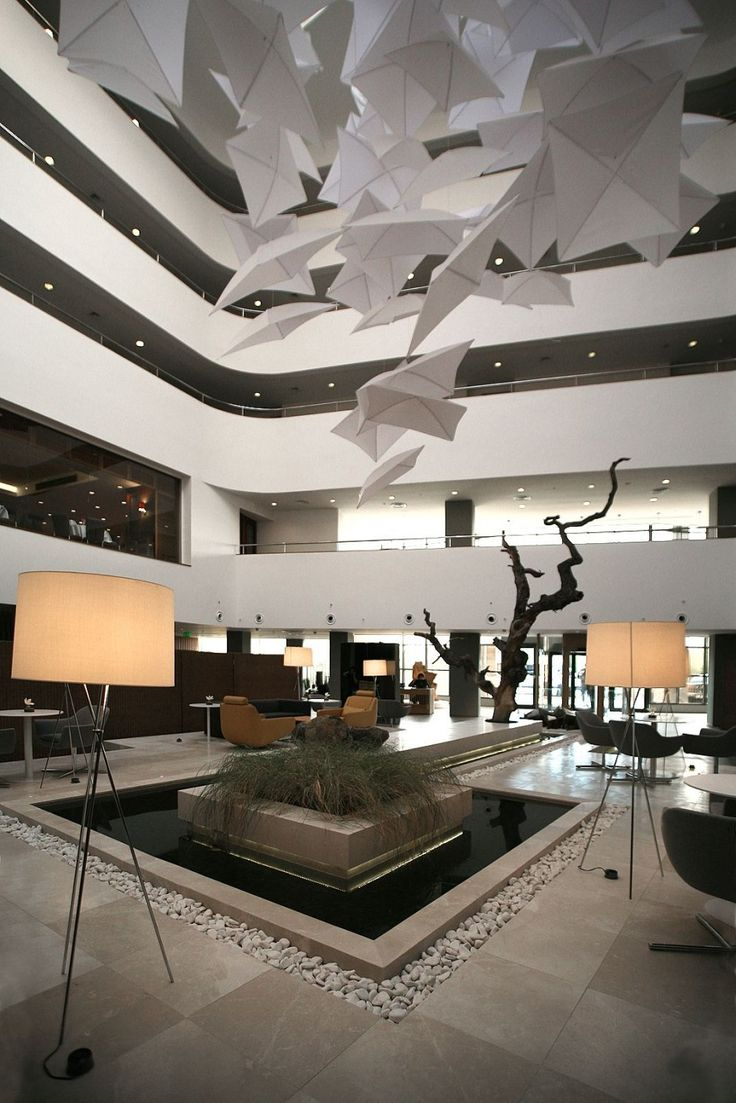 Radisson Hotel Lobby by Tanju zelgin: water feature, repetition, ceiling  element