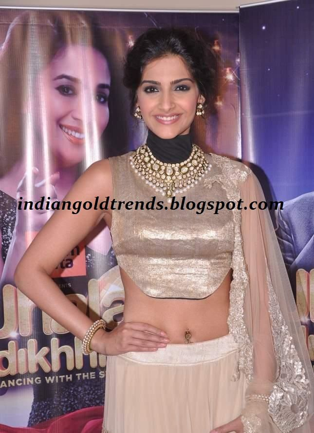 Latest Indian Gold and Diamond Jewellery Designs: Sonam Kapoor in designer polki diamond bridal necklace set with white pearls