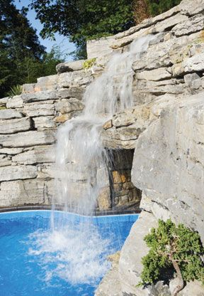 stacked stone waterfall grotto cave pool Concord Pools Spas NJ