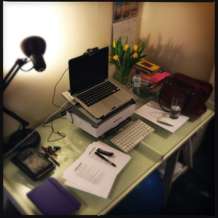 My desk in my basement flat in London. Check out those tulips :)